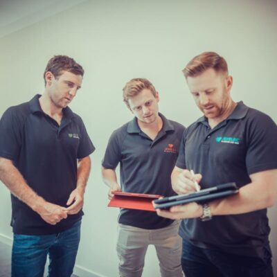 A photo of Bryn, Tory and Chad Djulbic planning a project. Jewelbic Brothers: Bathroom Renovations Perth