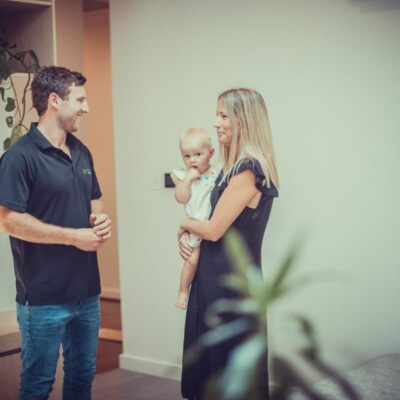 A photo of Bryn Djulbic talking to a customer. Jewelbic Brothers: Bathroom Renovations Perth